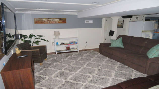 Lower level entertainment area with room for blow up mattresses (provided) for