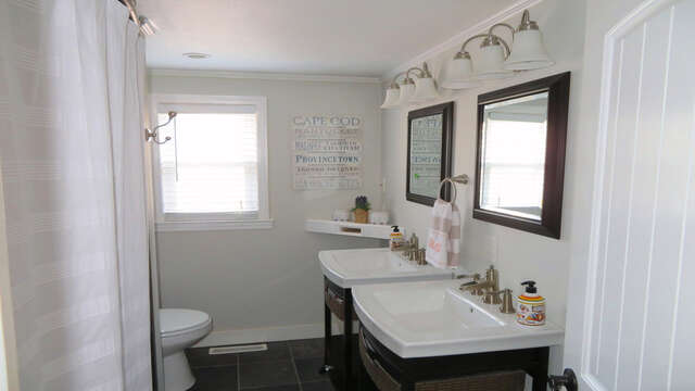 Full bath off of hallway with shower, tub and double sinks - 10 Seventh Street Harwich Cape Cod - New England Vacation Rentals