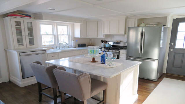 Open kitchen with stainless steel appliances and granite countertops - 10 Seventh Street Harwich Cape Cod - New England Vacation Rentals