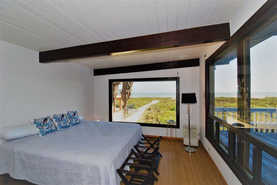 Master Bedroom with large windows overlooking the beach