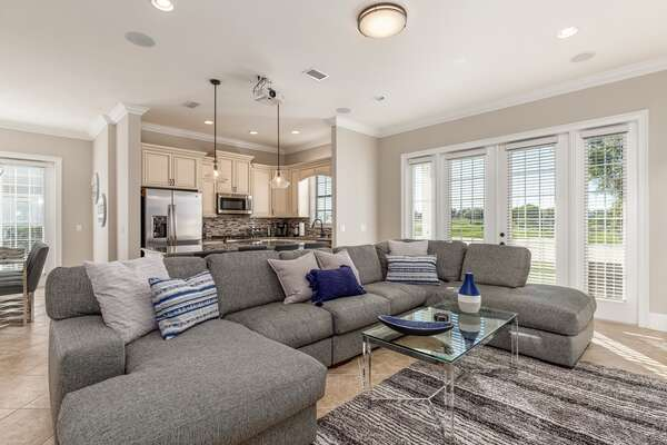 Head inside to a luxurious home with a spacious open living area