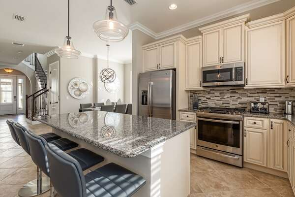 Enjoy the fully equipped kitchen, complete with stainless steel appliances and granite countertops