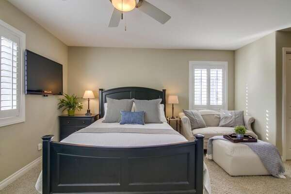 Spacious Master Bedroom with Extra Seating and Flat Screen TV
