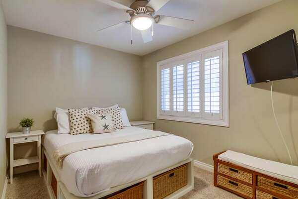 First Floor Guest Bedroom with a Queen Bed and Under Bed Storage