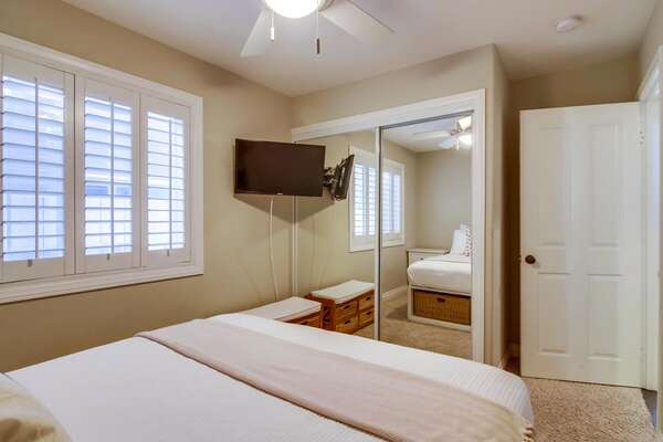 Guest Bedroom on the First Floor Has a Mounted TV