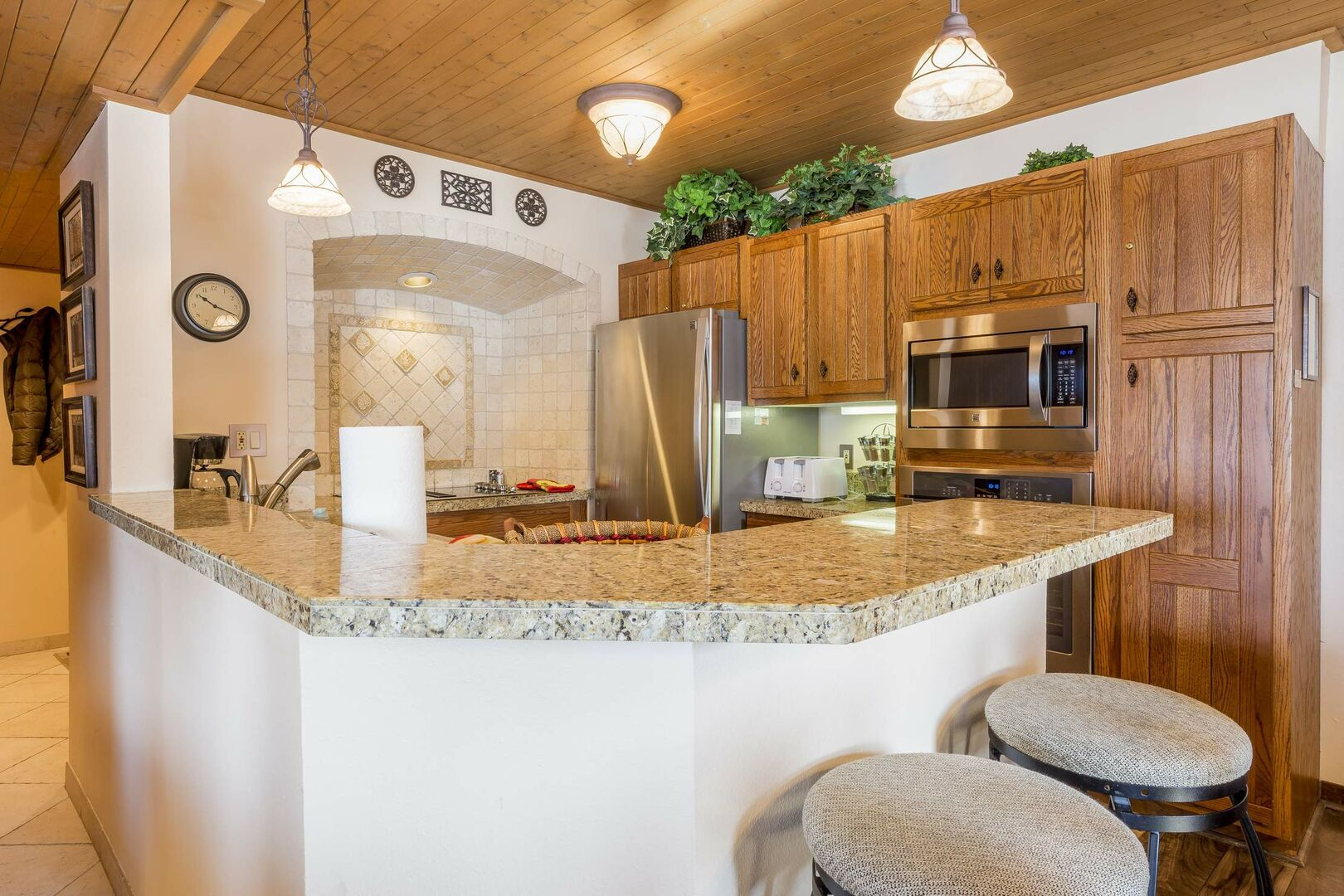 Well equipped kitchen with wood cabinets and stainless steel appliances
