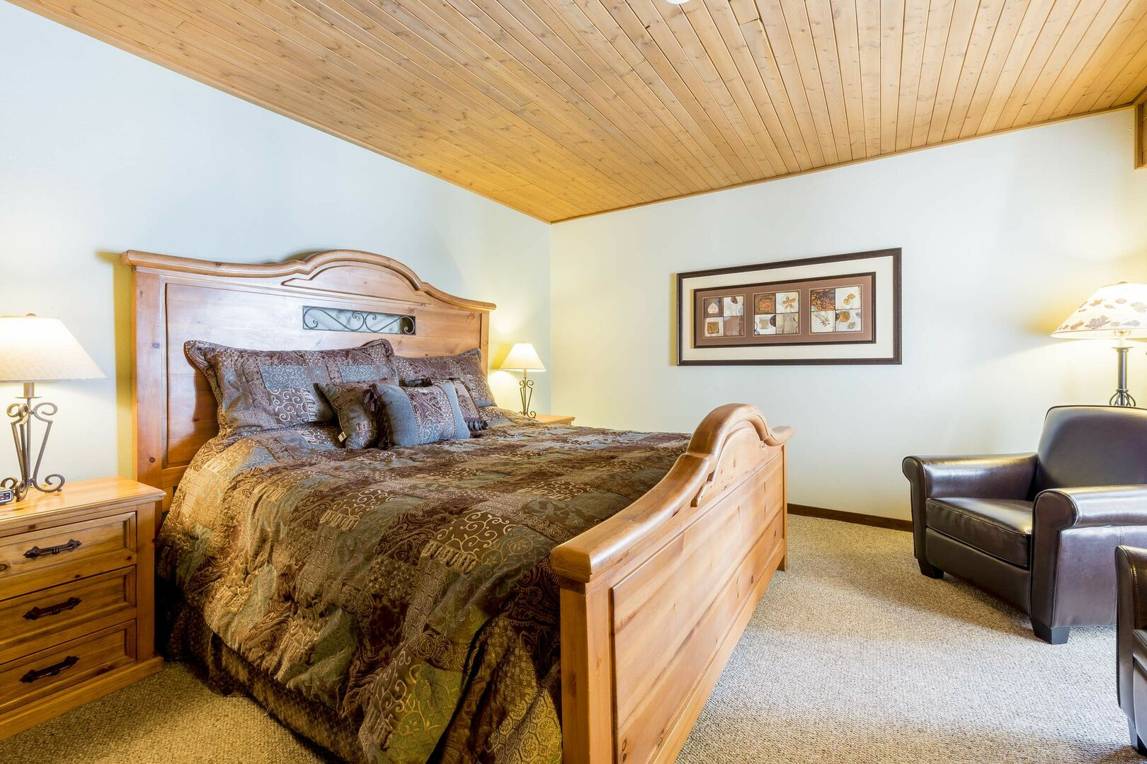 A king bed with large wood frame centers the Master bedroom suite
