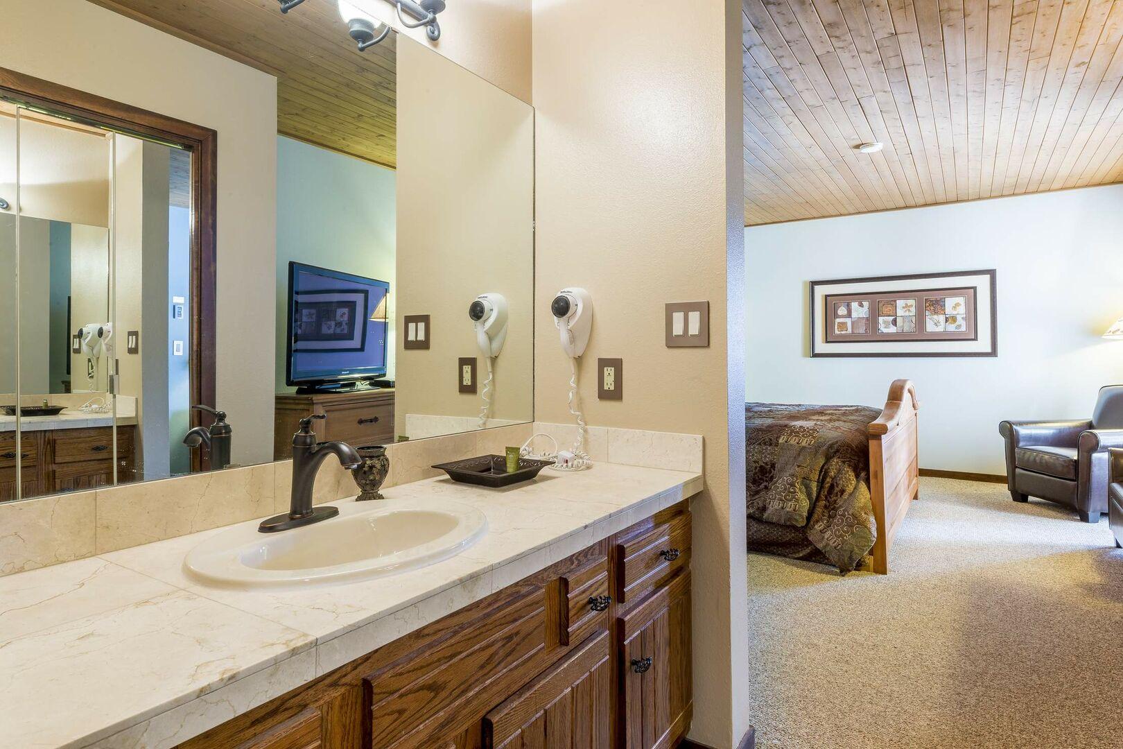 Master bathroom vanity includes a hair dryer