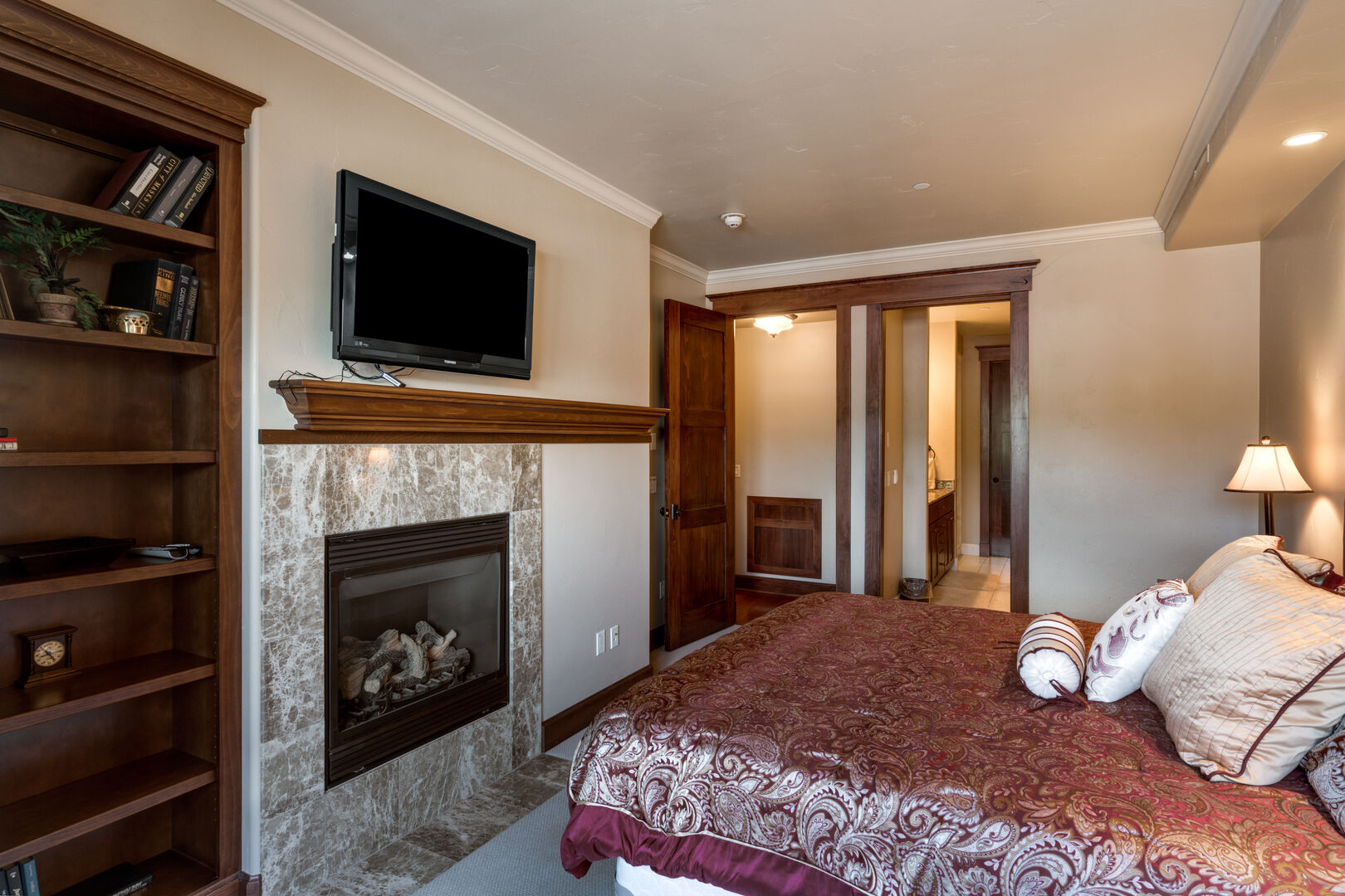Master Suite Features a Fireplace and TV