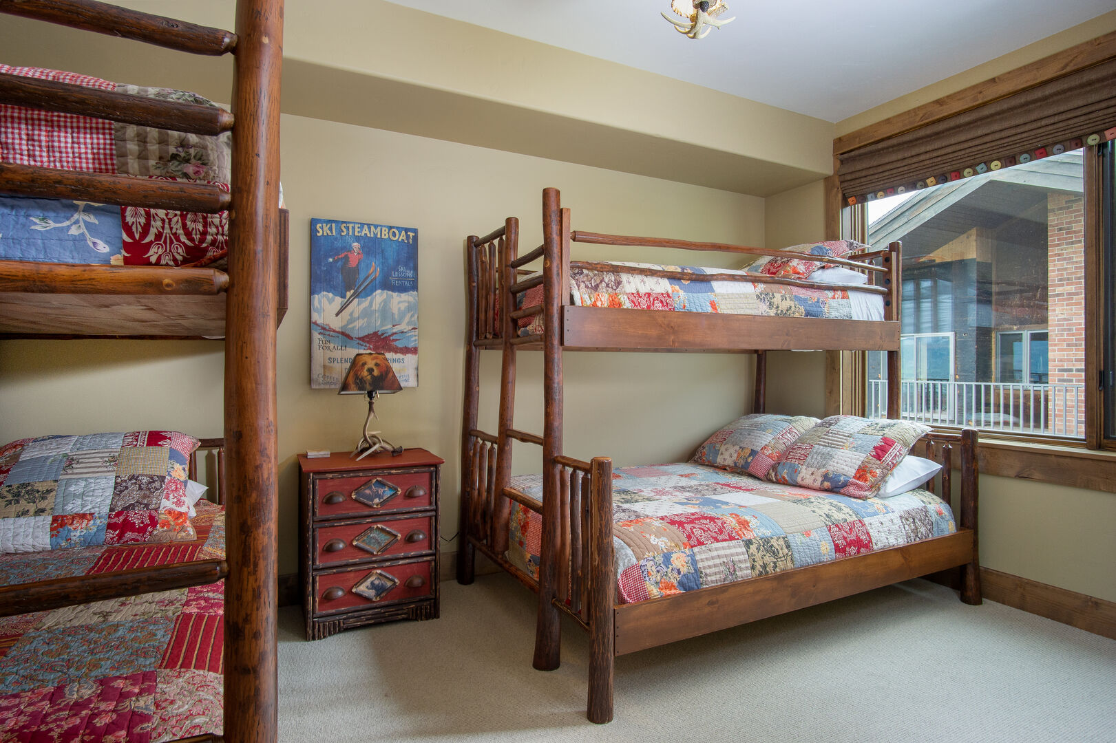 Bedroom with Two Bunk Beds and Nightstand.