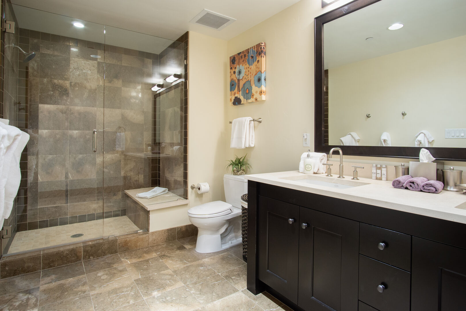 Bathroom with Large Shower, Double Sink Vanity, and Mirror.