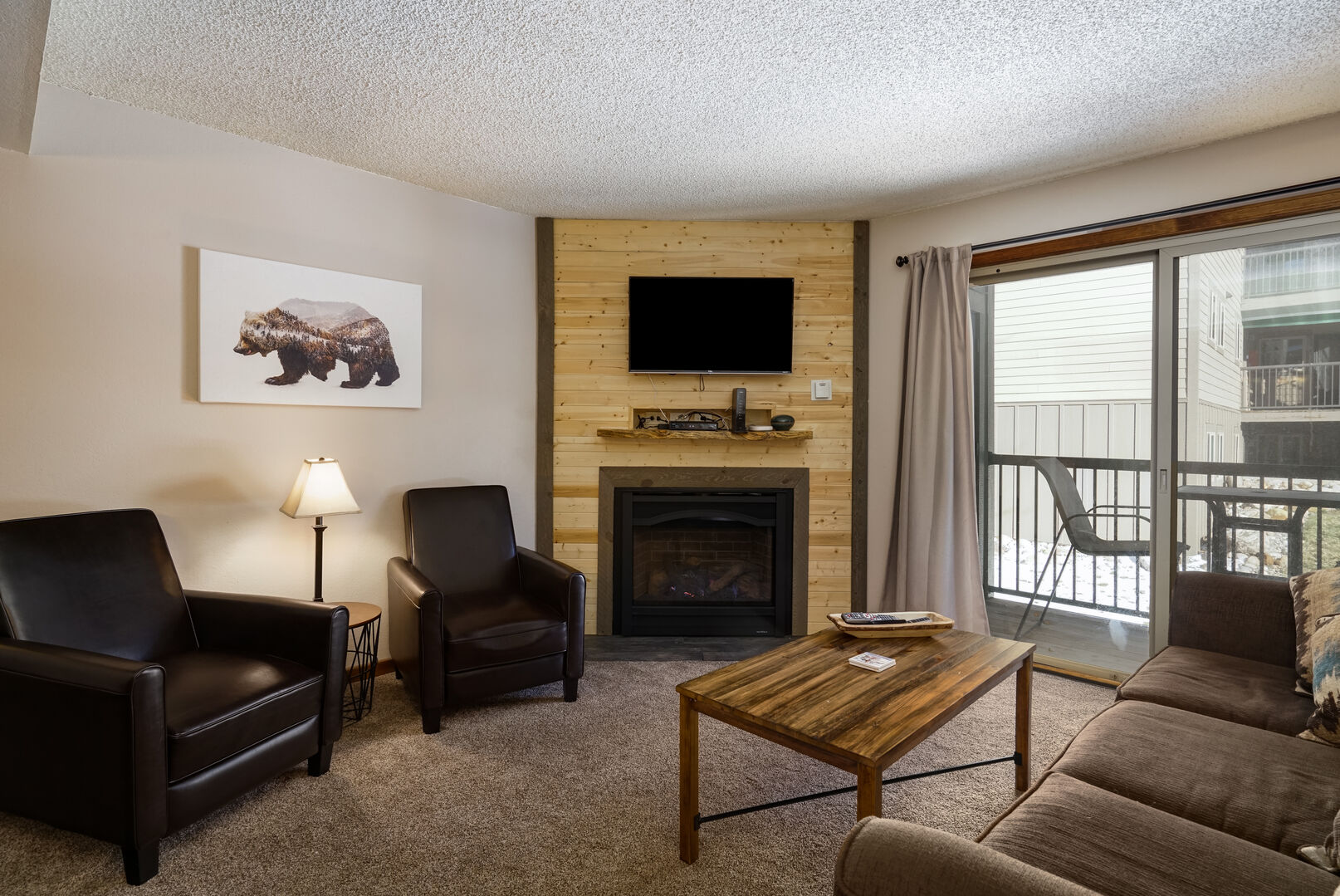 Living area with gas fireplace, balcony and new furnishings!