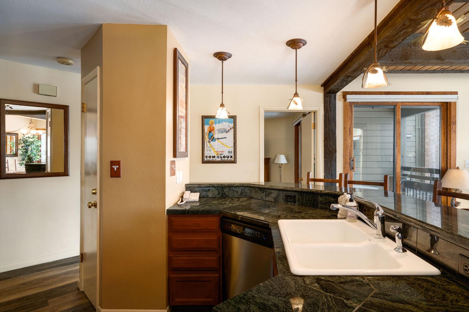 Open Kitchen, granite countertops, bright, spacious Lodge unit!!
