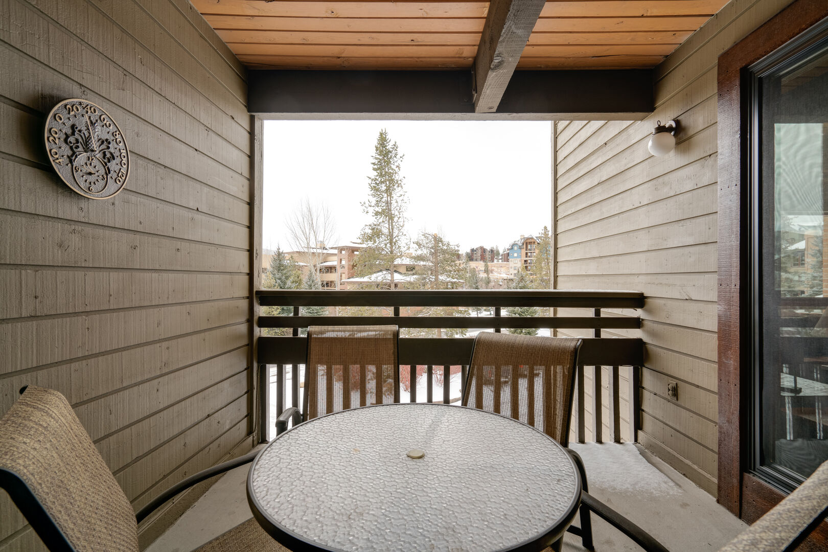 Covered patio with table and chairs