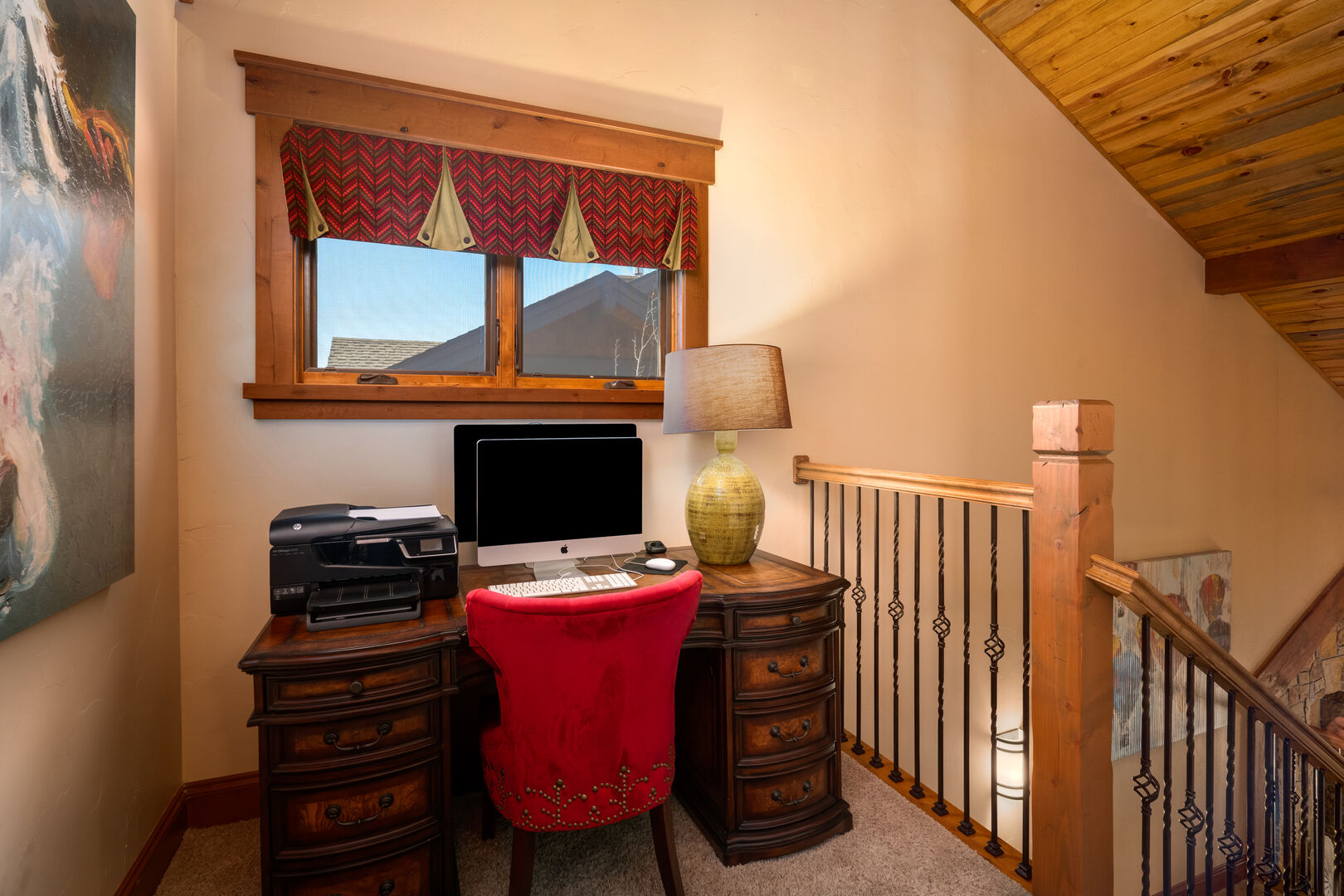 A quiet nook outside the upper level king bedroom with desk and large screen to complete some work while out of town.