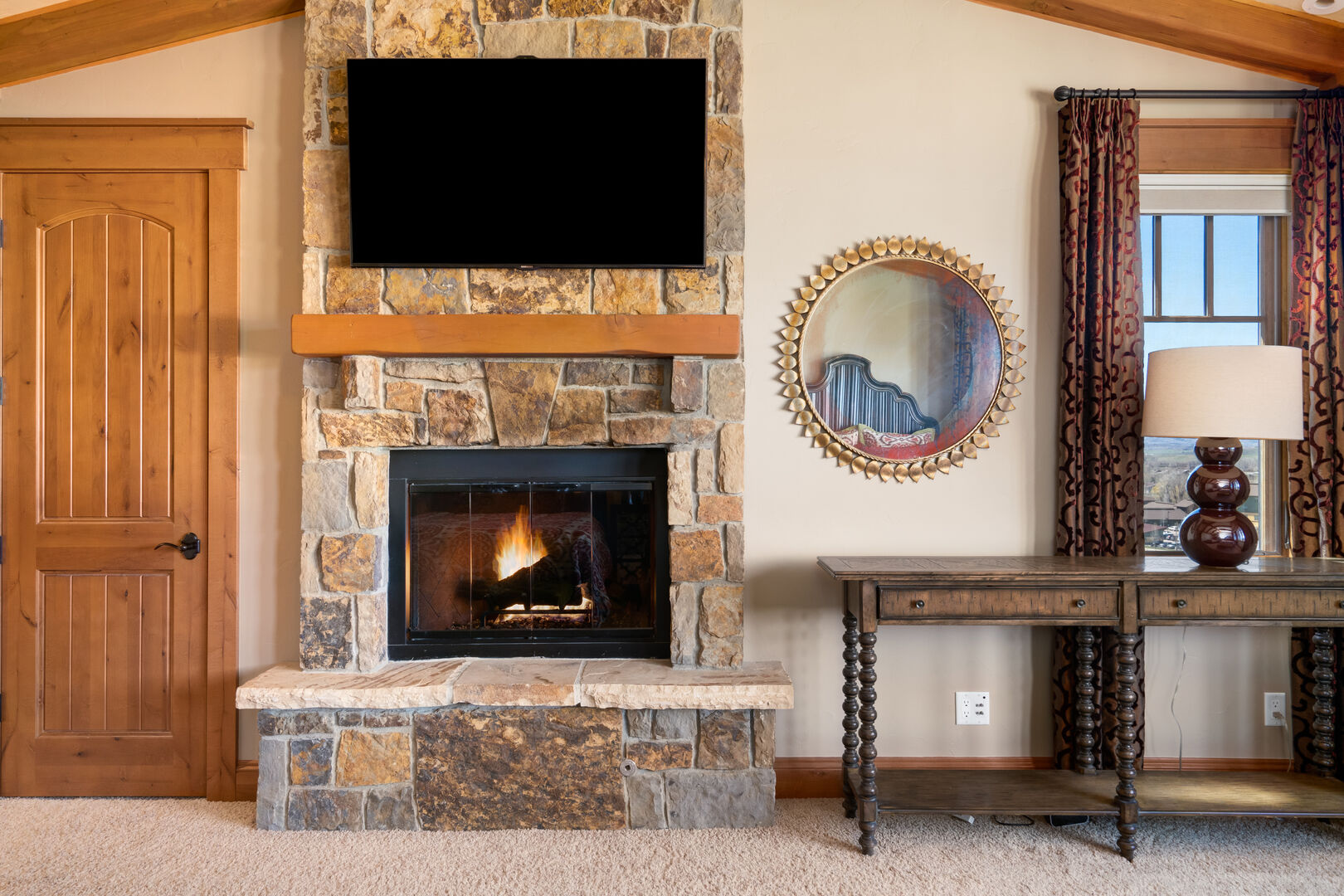 Double queen bedroom with gas fireplace and TV to spend some quiet time away from the group.