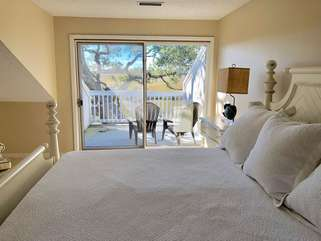 Sliding doors lead to private deck off master bedroom