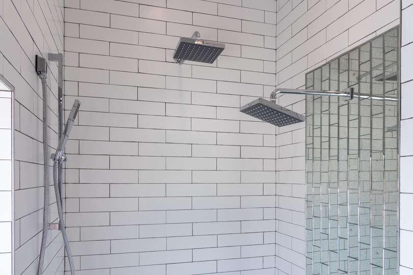 Bathroom Shower Features Three Shower Heads.