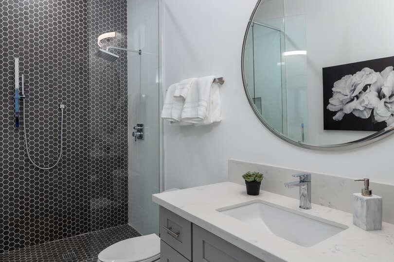 Modern Bathroom Featuring Sink, Mirror, and Shower.