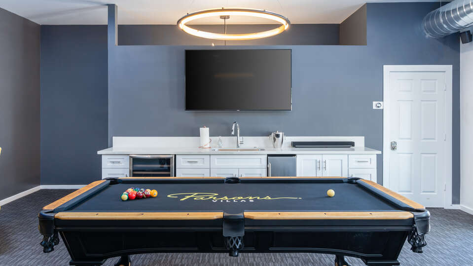 Large Pool Table in Front of Large Television.