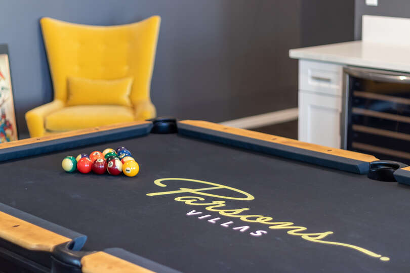 Image of Pool Table and Yellow Accent Chair.