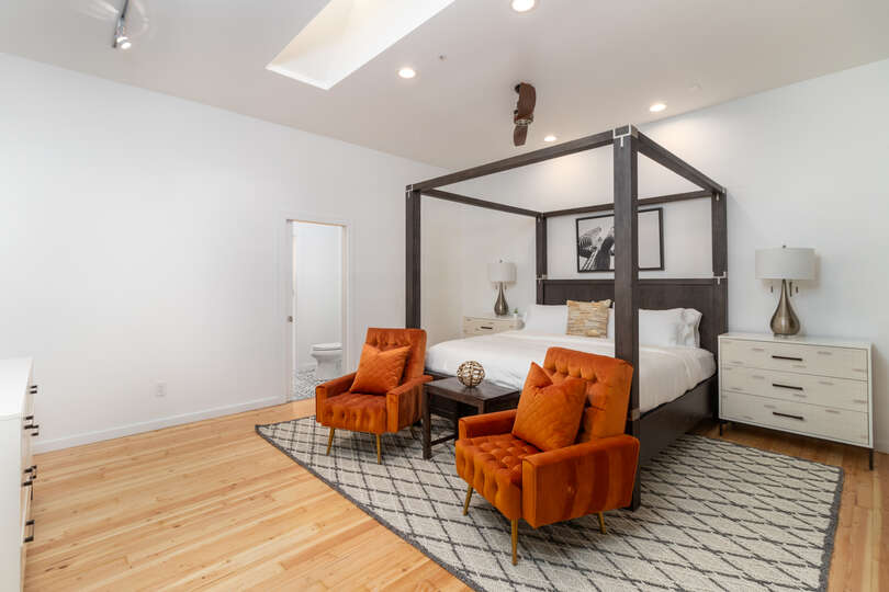 Large Bedroom Featuring Colorful Accent Pieces.
