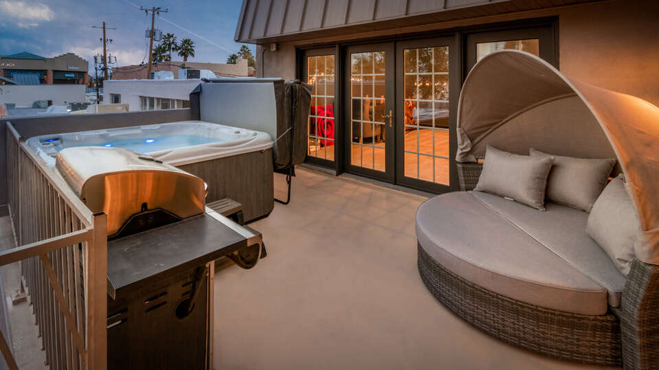 Hot Tub, Grill, and Lounge Chair Featured on Patio.