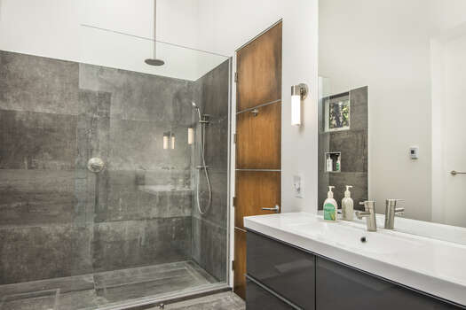 Shared Full Bath with a Dual Head Tile Shower