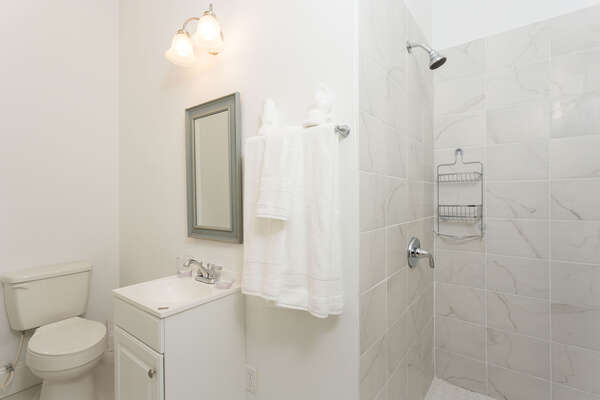 This ensuite master bathroom has a beautiful walkin shower