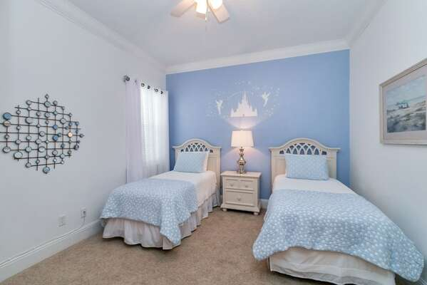 A lovely bedroom with twin beds on the first floor
