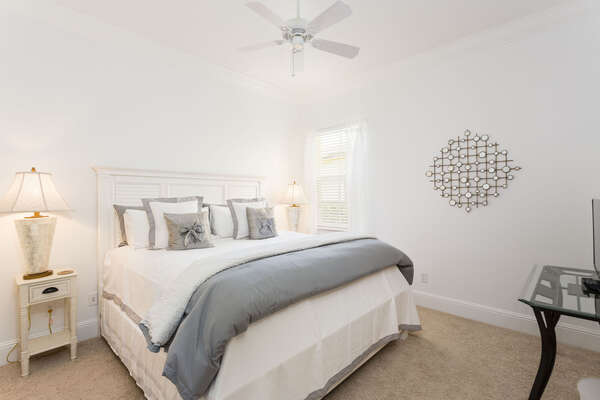 This tastefully decorated master bedroom has yet another King bed