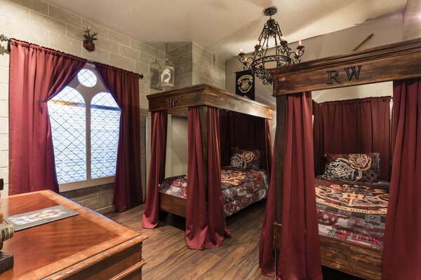 Kids will love this custom bedroom with two twin four poster beds