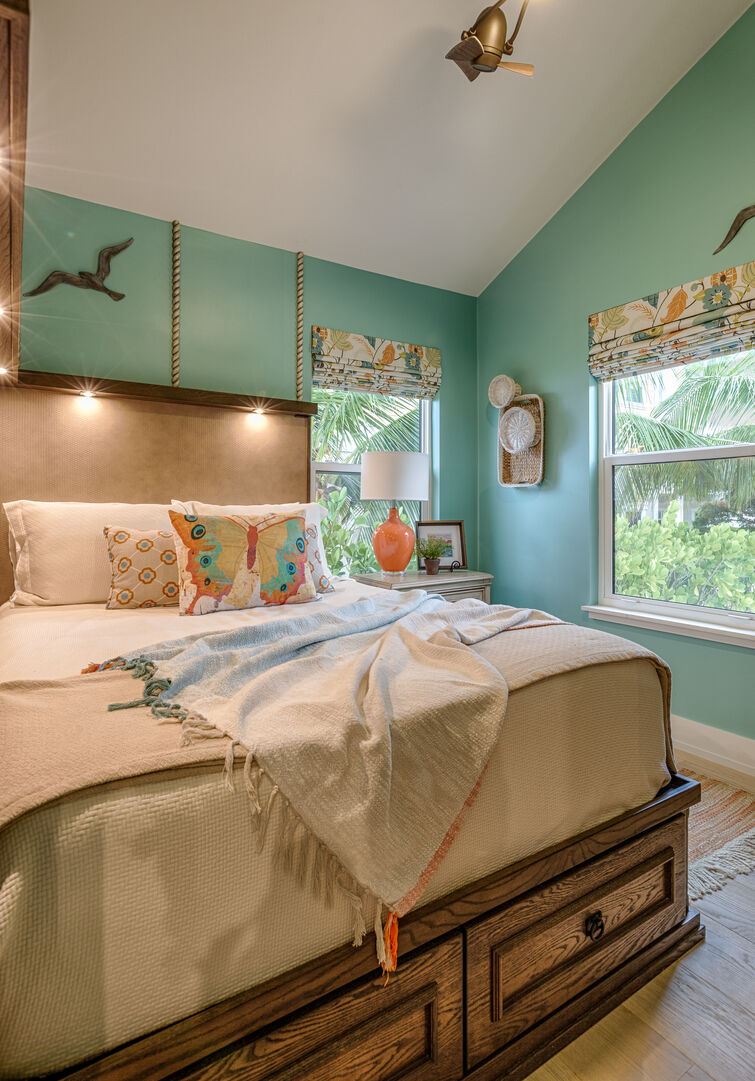 Bedroom with Light Blue Walls at Beach Rental Fort Myers Beach