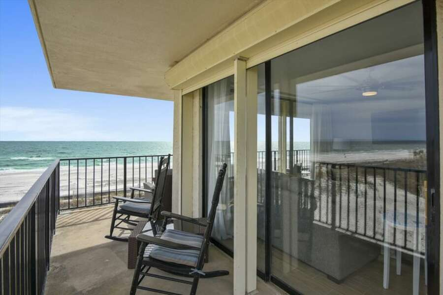 Large private balcony offers gorgeous views of the beach and gulf waters.