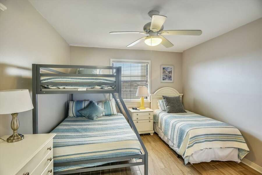 2nd Guest Room has a double bed and 2 twin beds.