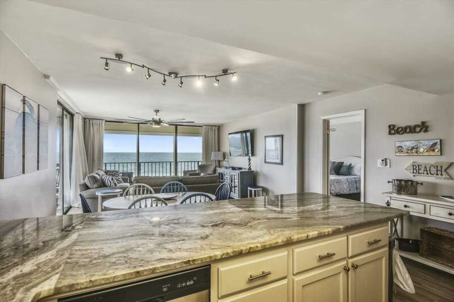 The fully equipped kitchen with stainless appliances and granite counter tops.