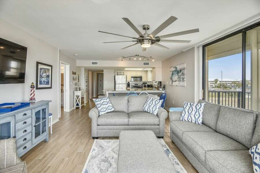 The spacious living room has plenty of comfortable seating and a double size sleeper sofa.