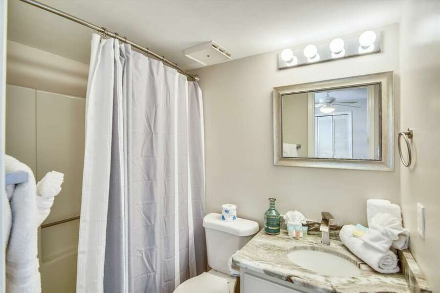 Private Guest Bath with shower/tub combo and granite counter top.