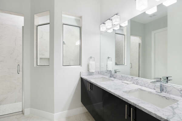 Beautiful bathroom countertops with a dual vanity and walk in shower