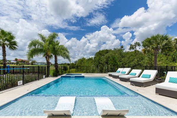 The custom built pool includes a sun ledge with 2 ledge loungers