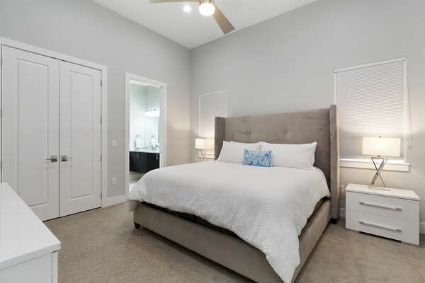 Sleep peacefully in this master suite with a king size bed