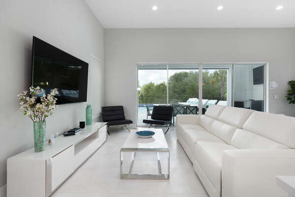 Cool off on the leather sofa seating in the living area