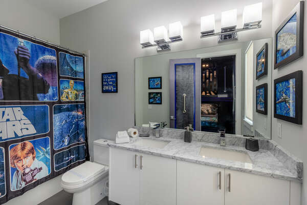 Custom themed bathroom to match with a dual vanity