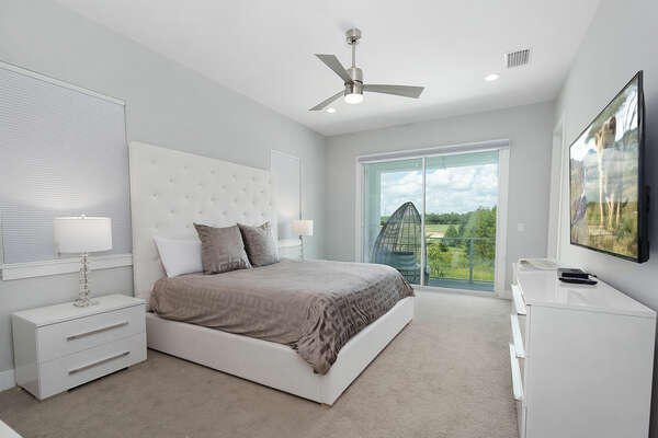 A beautiful master suite that has access to the second floor balcony