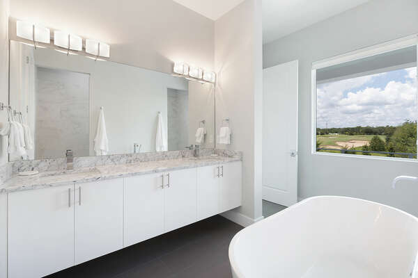 The ensuite bathroom with a garden tub and dual vanity