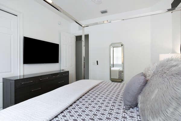 SMART TV and dresser inside large closet