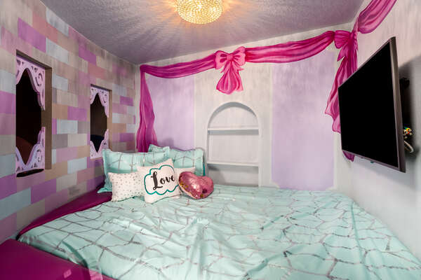 This bedroom features a SMART TV so the princesses can watch all their favorite movies and tv shows