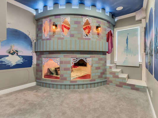 A magical castle awaits princesses in this amazing custom built full over full bed