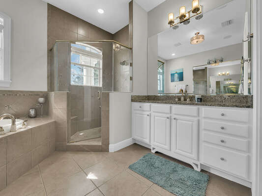 The master bathroom has a large walk-in closet, shower and his and her sinks