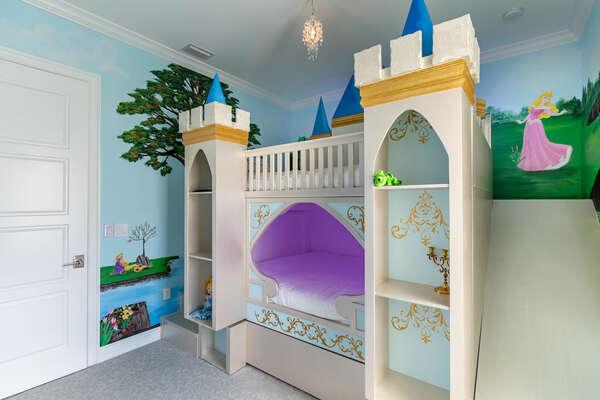 A custom-built castle bunkbed awaits them with cubby storage